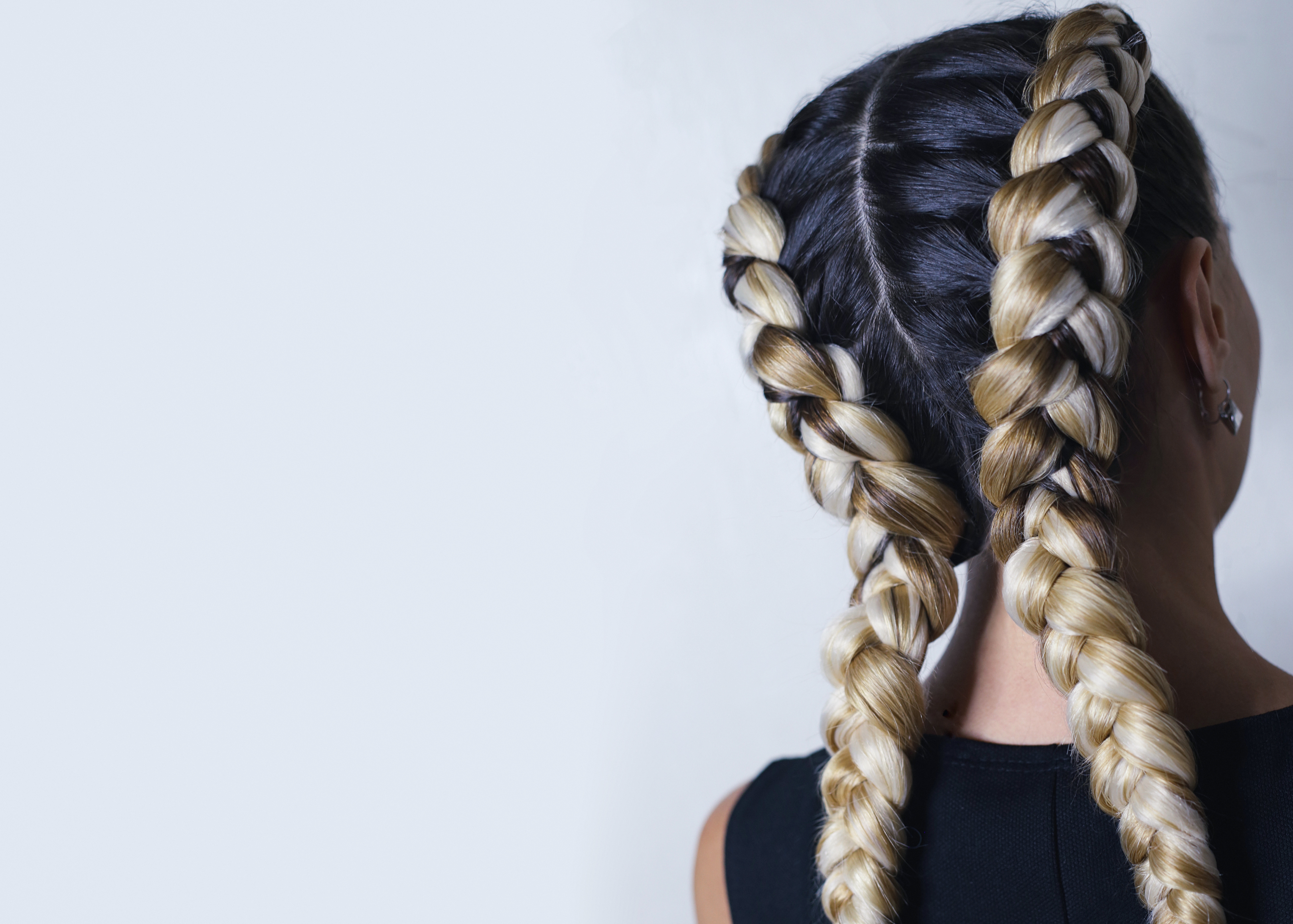 two thick braids of artificial hair, a youth hairdo, colored hai