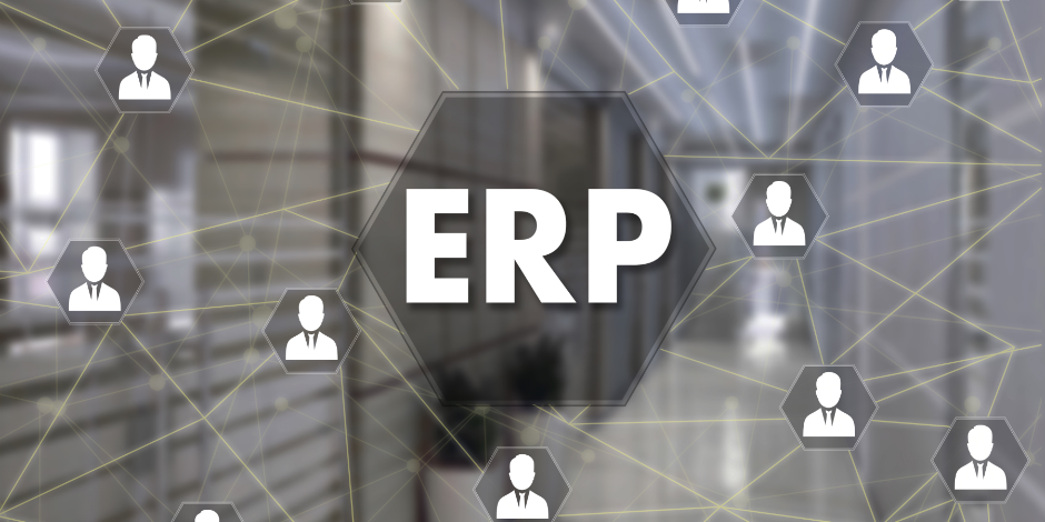 Enterprise Resource Planning. ERP  on the touch screen with a blur background of the office.The concept of Enterprise Resource Planning, ERP