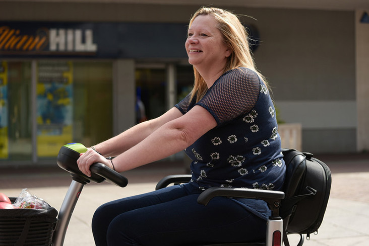 Motability Scheme customer on scooter
