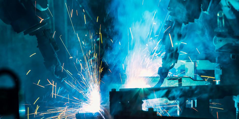 Team robots are welding in factory