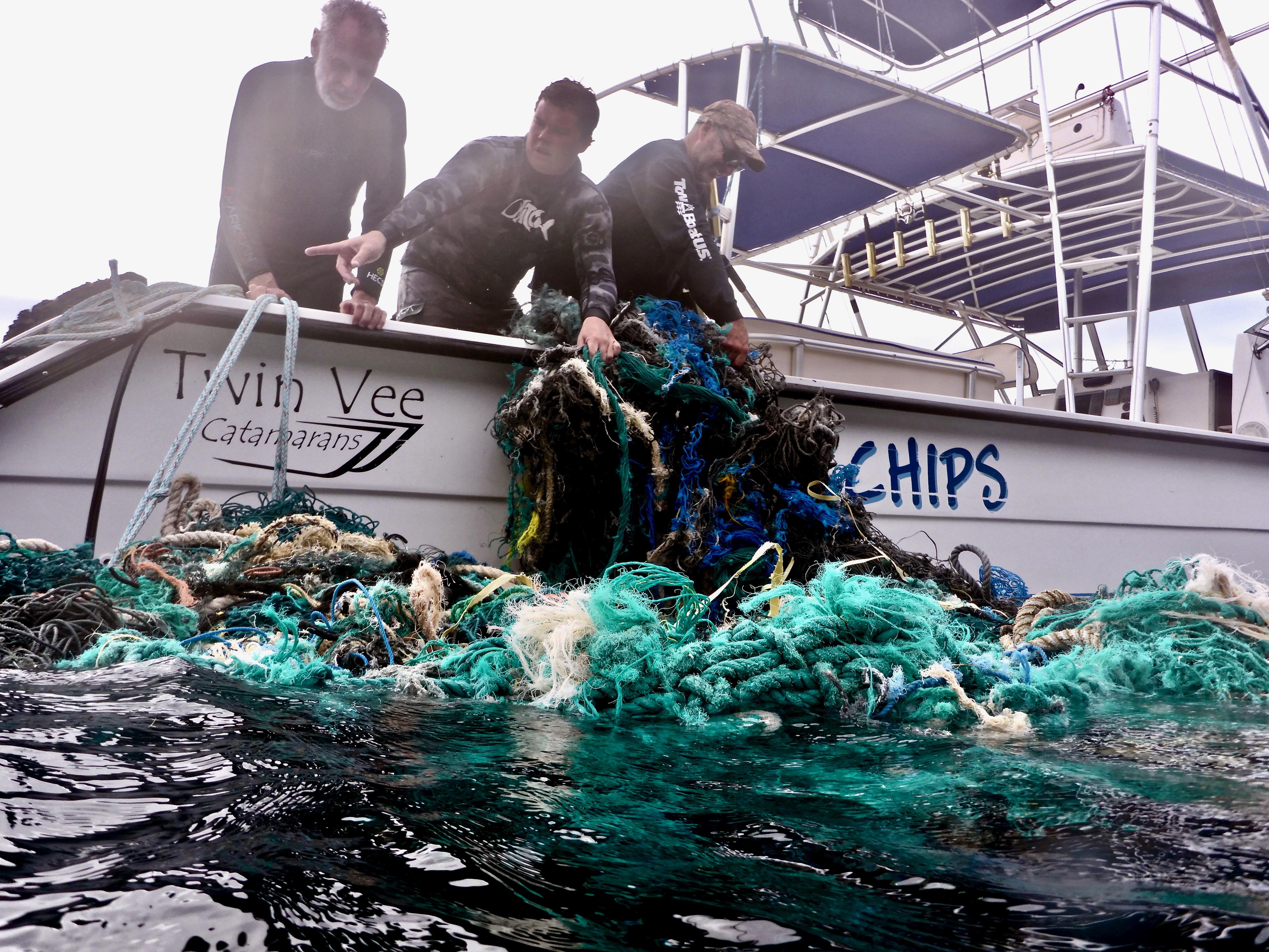 Sven Hauling Nets On Boat.jpg