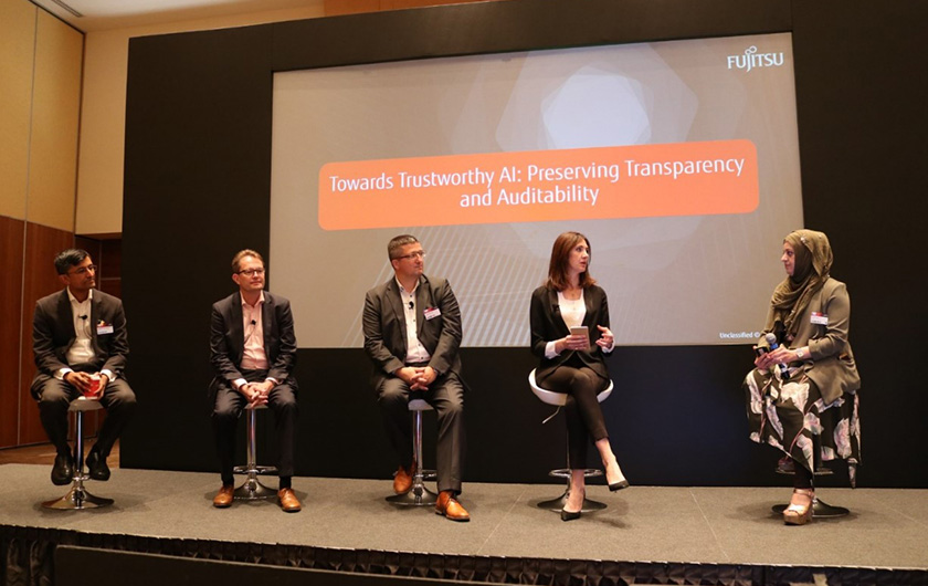 "Photo :Fujitsu innovation gathering in July 2019 that focused on AI and ethics, including a panel discussion titled, ""Towards Trustworthy AI: Transparency and Auditability"""