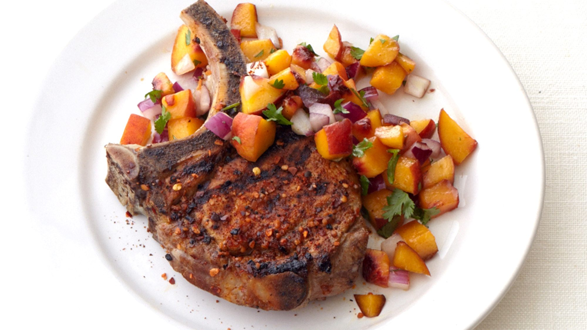 McCormick Southwestern Spiced Pork Chops with Peach Salsa