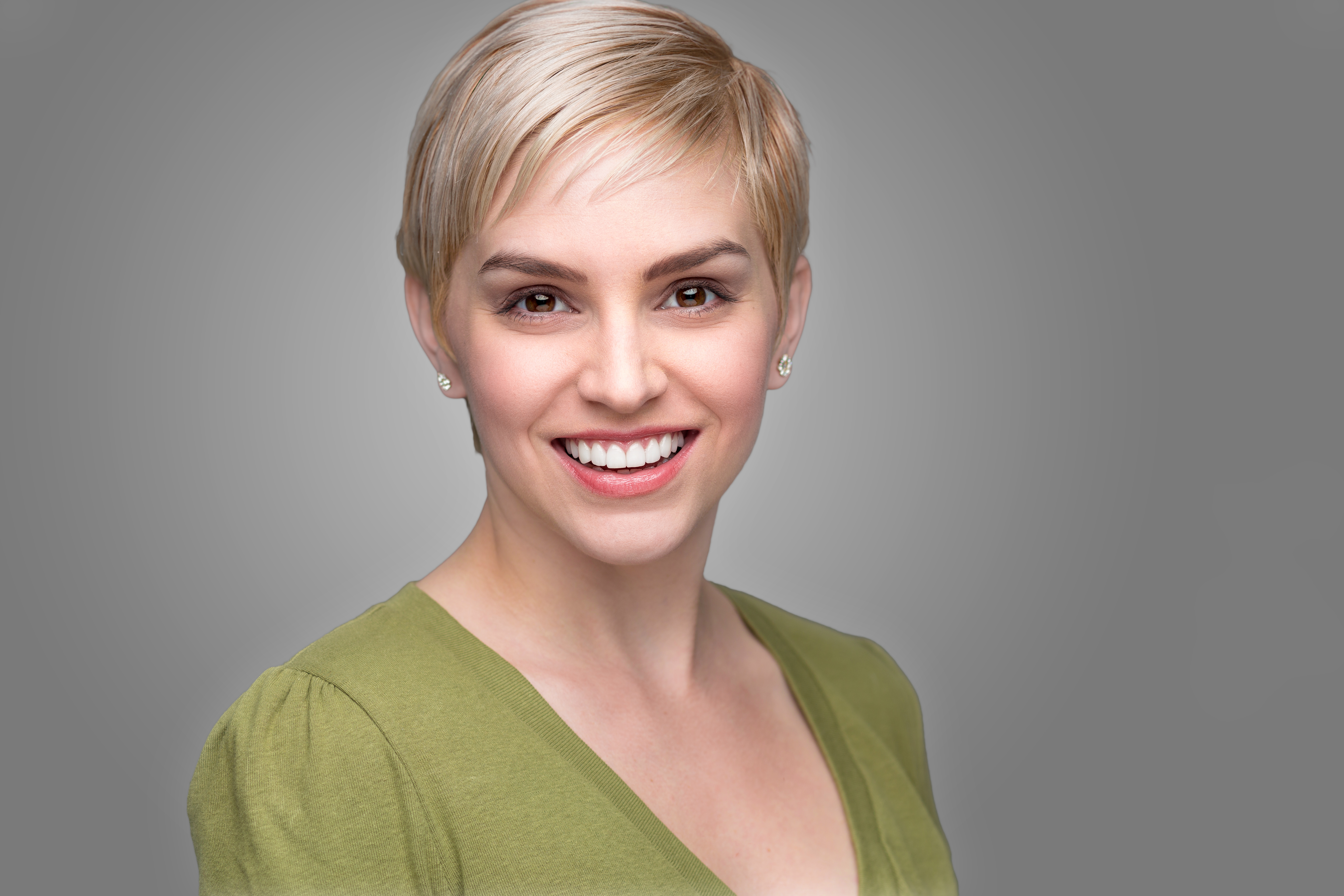 woman with a short blonde pixie cut.jpg