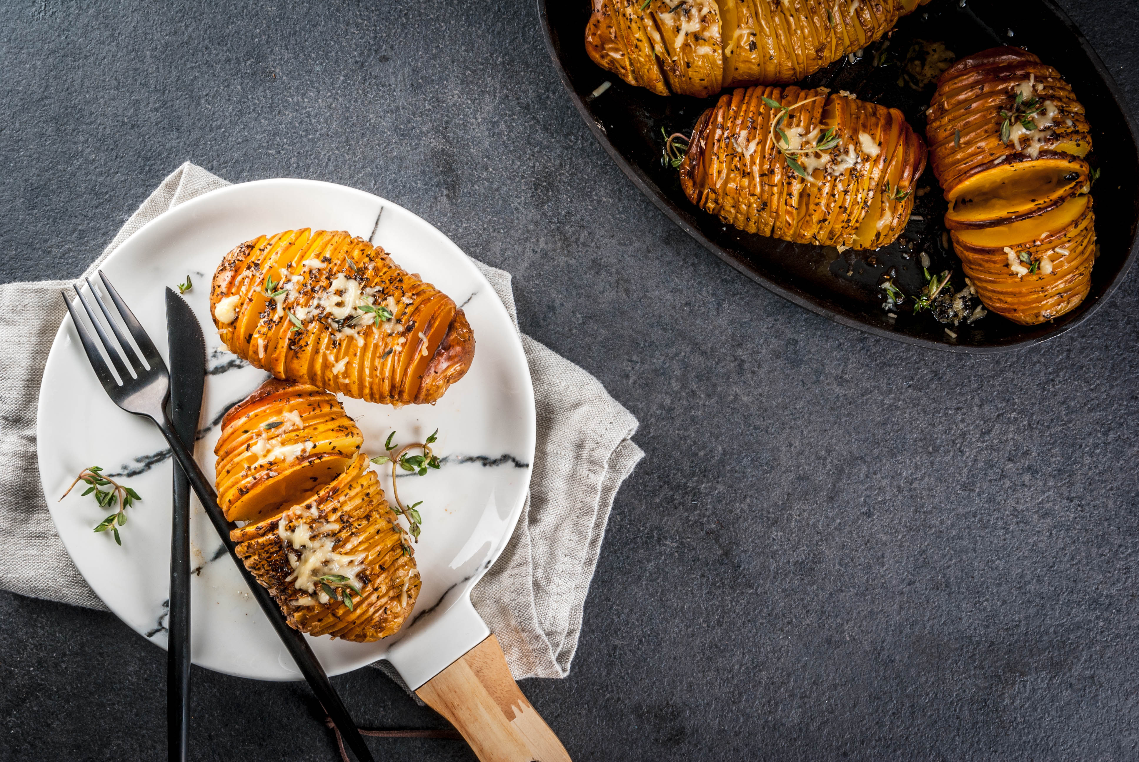 Cheesy Hasselback Potato with Fresh Herbs