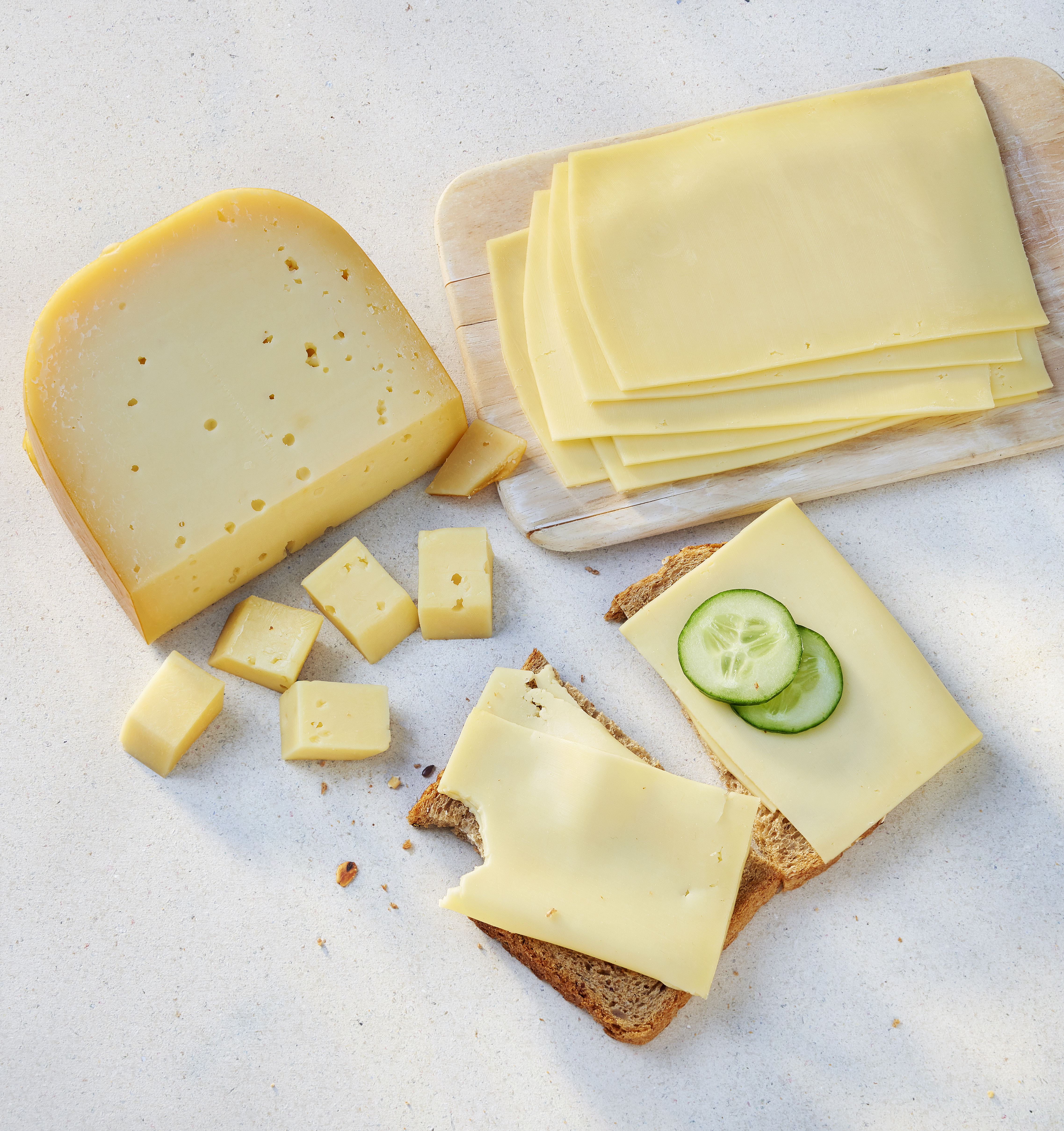 cheese pieces and slices on a slice of bread