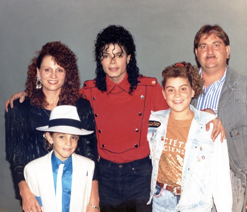 "Wade Robson wears a suit from the ""smooth criminal"" music video and poses with his family and Michael Jackson"
