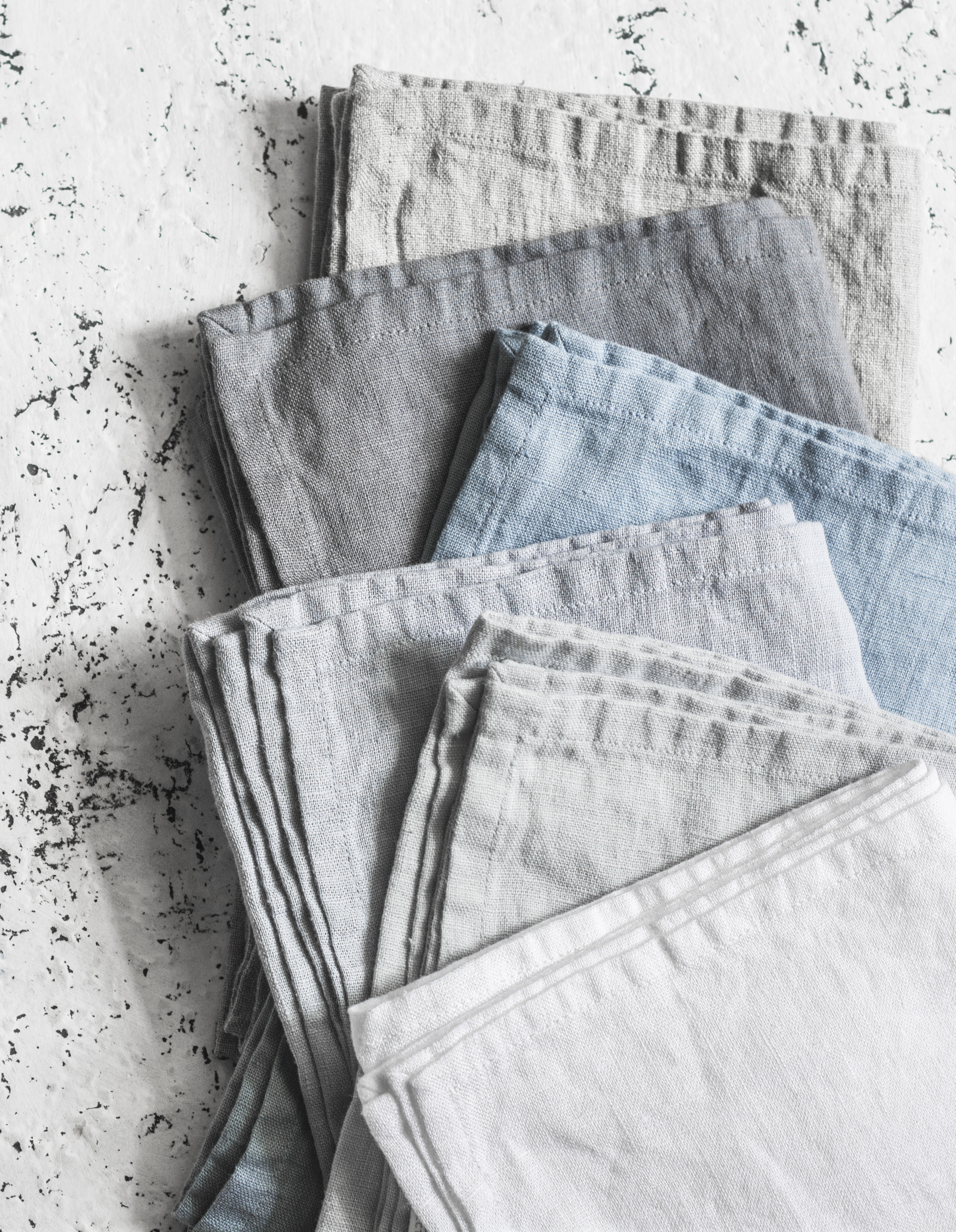 Rustic linen kitchen napkins on a light background. Pastel shades