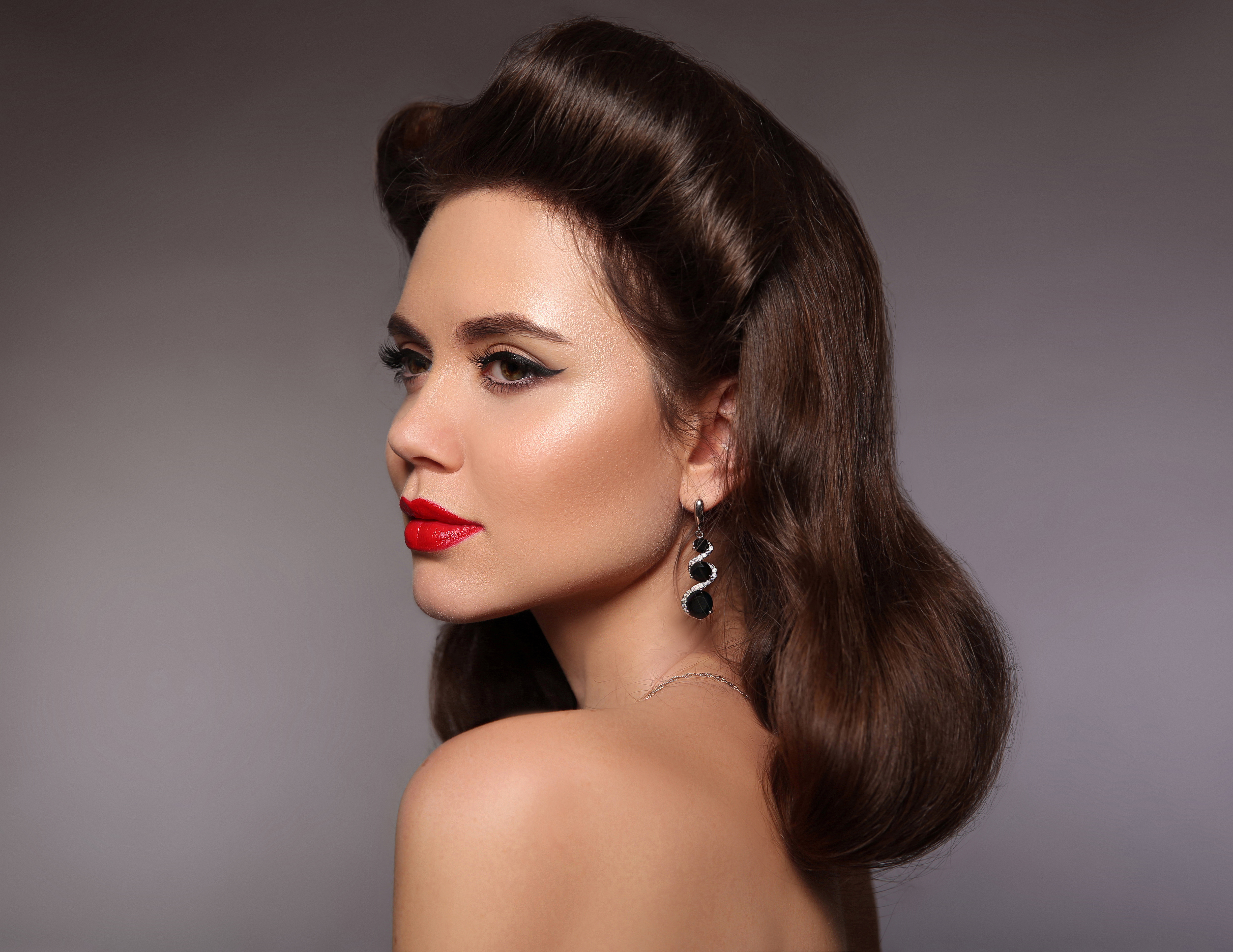 woman with brown, voluminous hair and red lipstick.jpeg