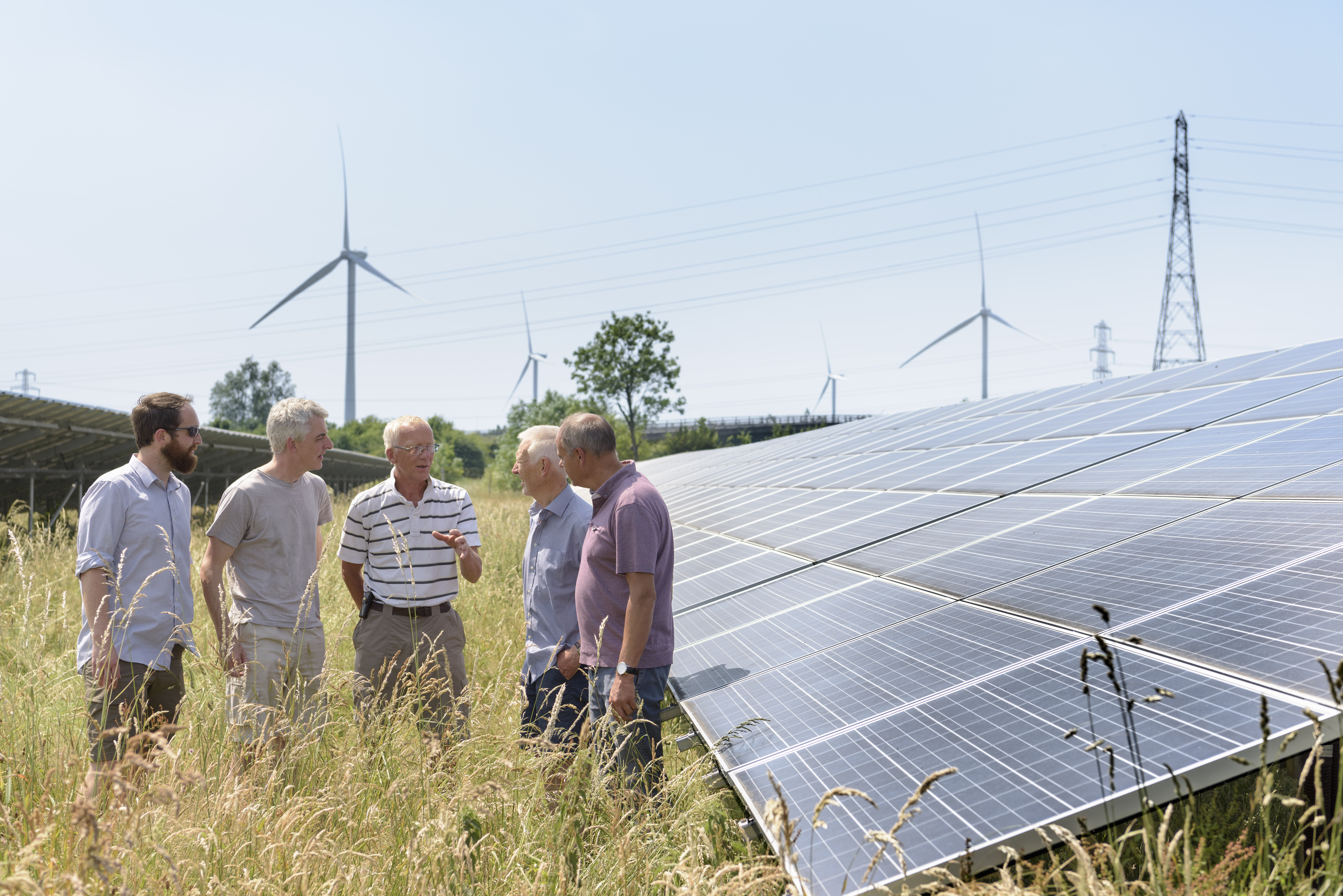 Local community members discussing their solar farm