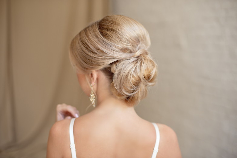blonde updo hairstyle, back of a woman's head.jpg
