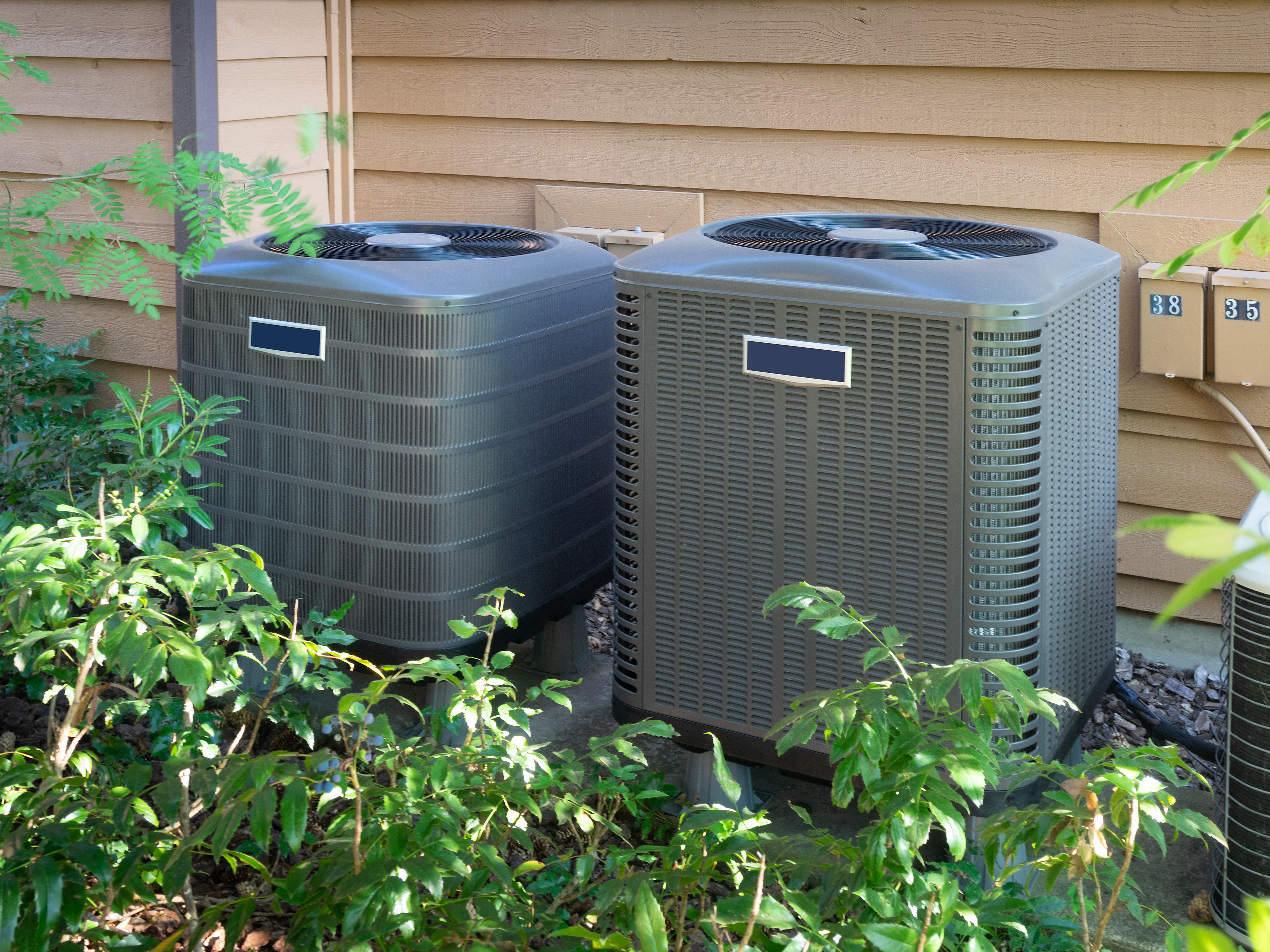 Air conditioning units outside an apartment complex
