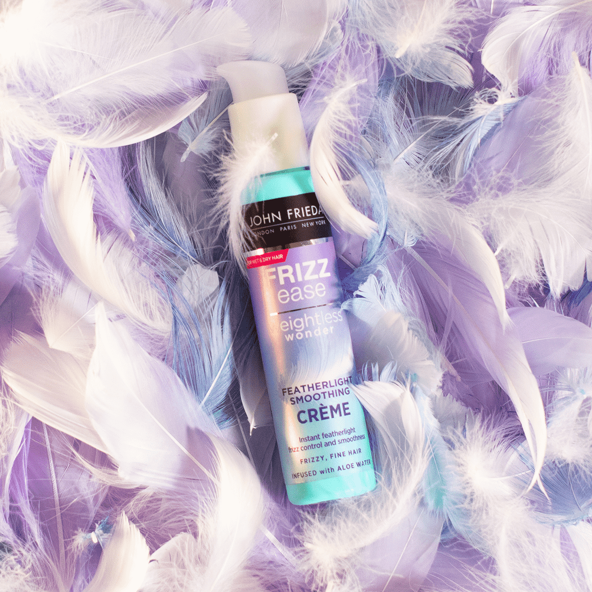 John Frieda product surrounded by feathers