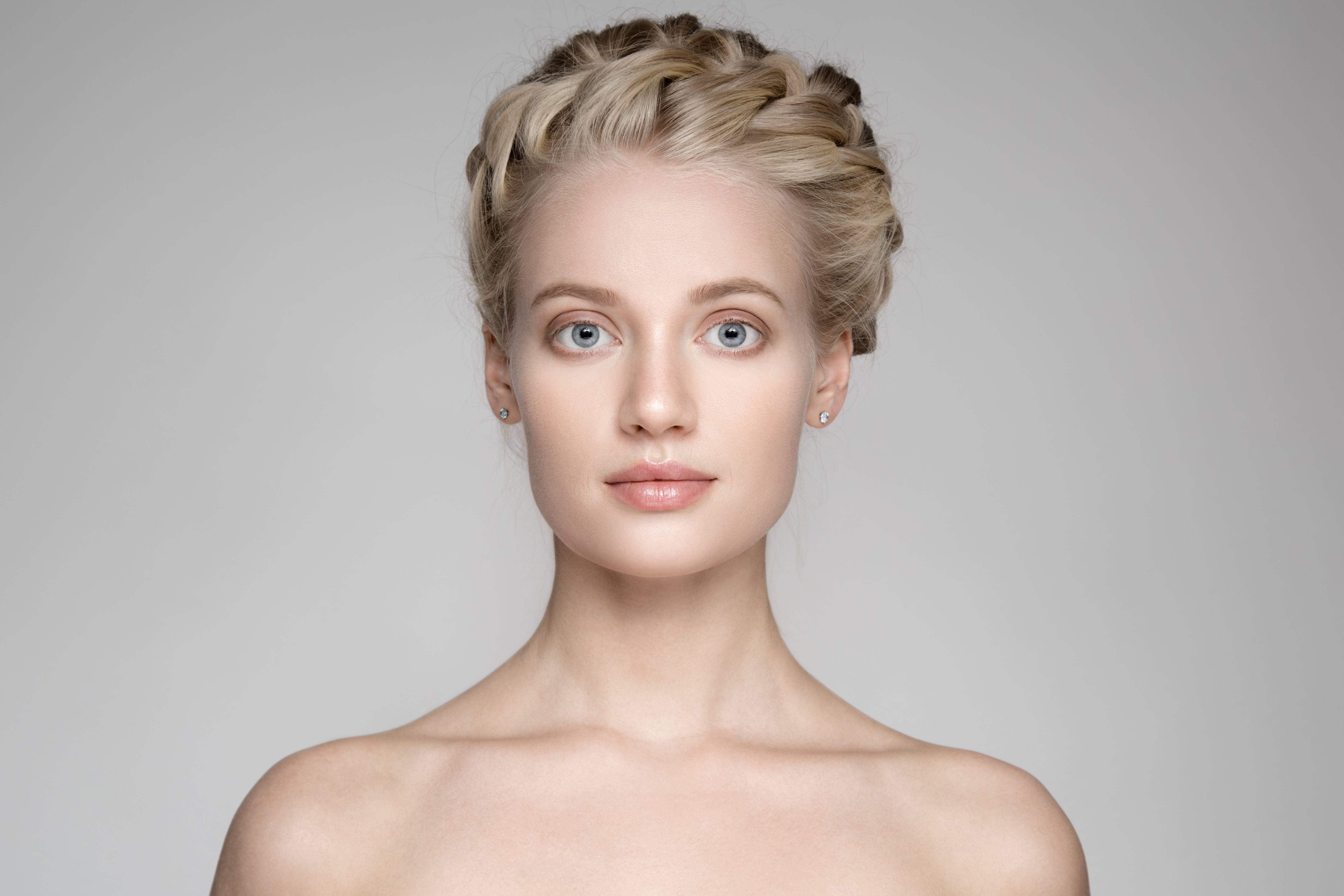 Portrait Of A Beautiful Young Blond Woman With Braid Crown Hairs