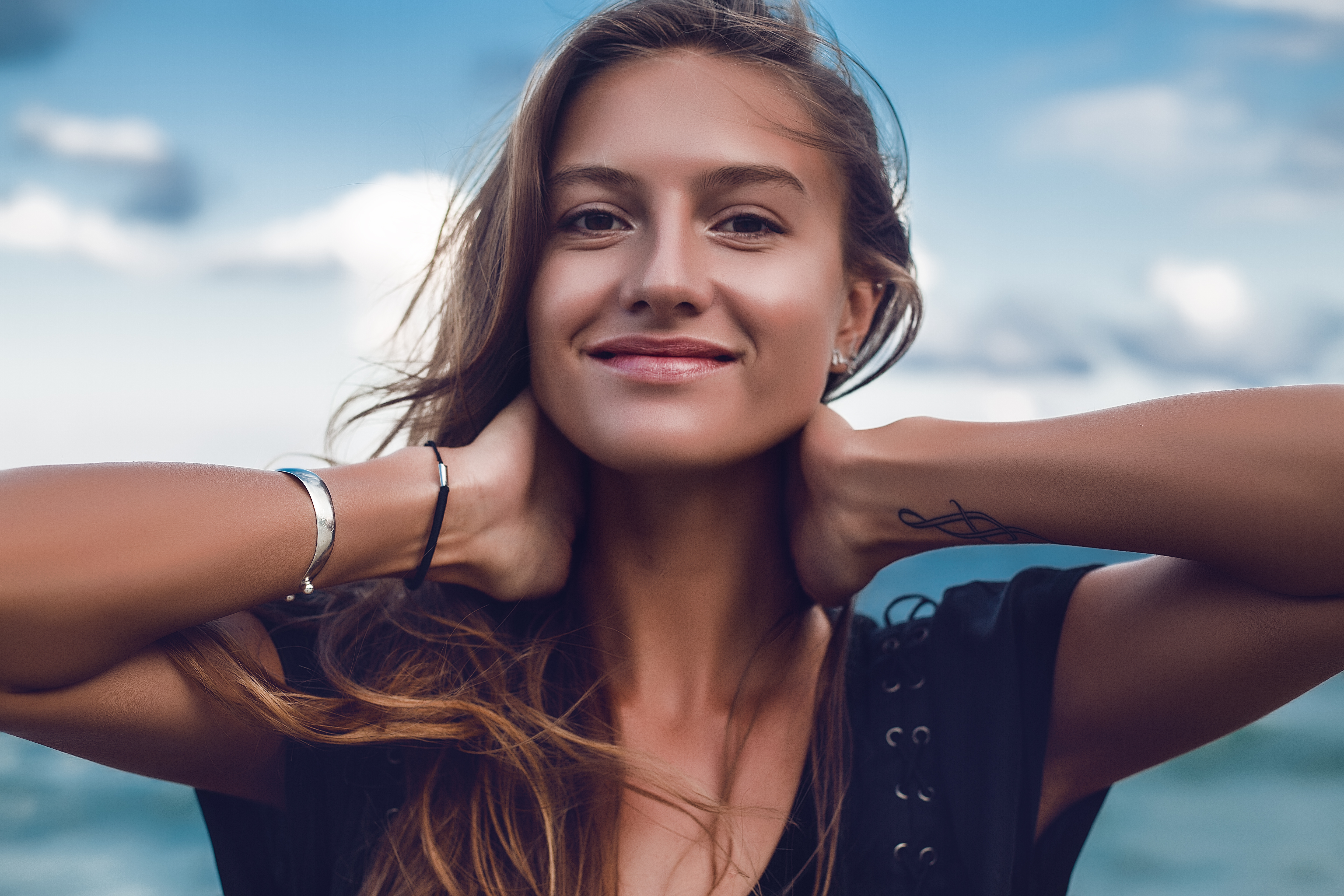 Portrait of happy young woman on beach, head and shoulders, Odessa, Odessa Oblast, Ukraine