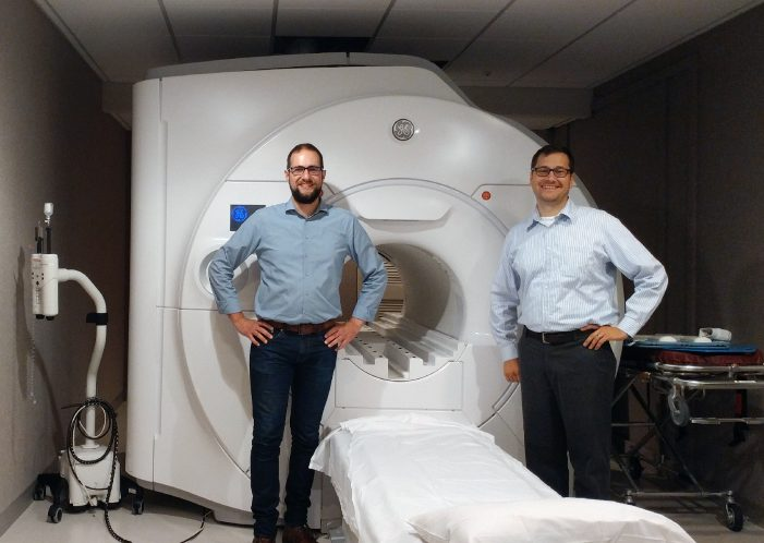 Samuel A. Hurley, Ph.D., Postdoctoral PET/MR Physicist, Department of Neuroscience, Department of Radiology, University of Wisconsin – Madison and Alan McMillan, PhD, Wisconsin Institutes for Medical Research, Department of Radiology, University of Wisconsin – Madison pictured with the SIGNA Premier.