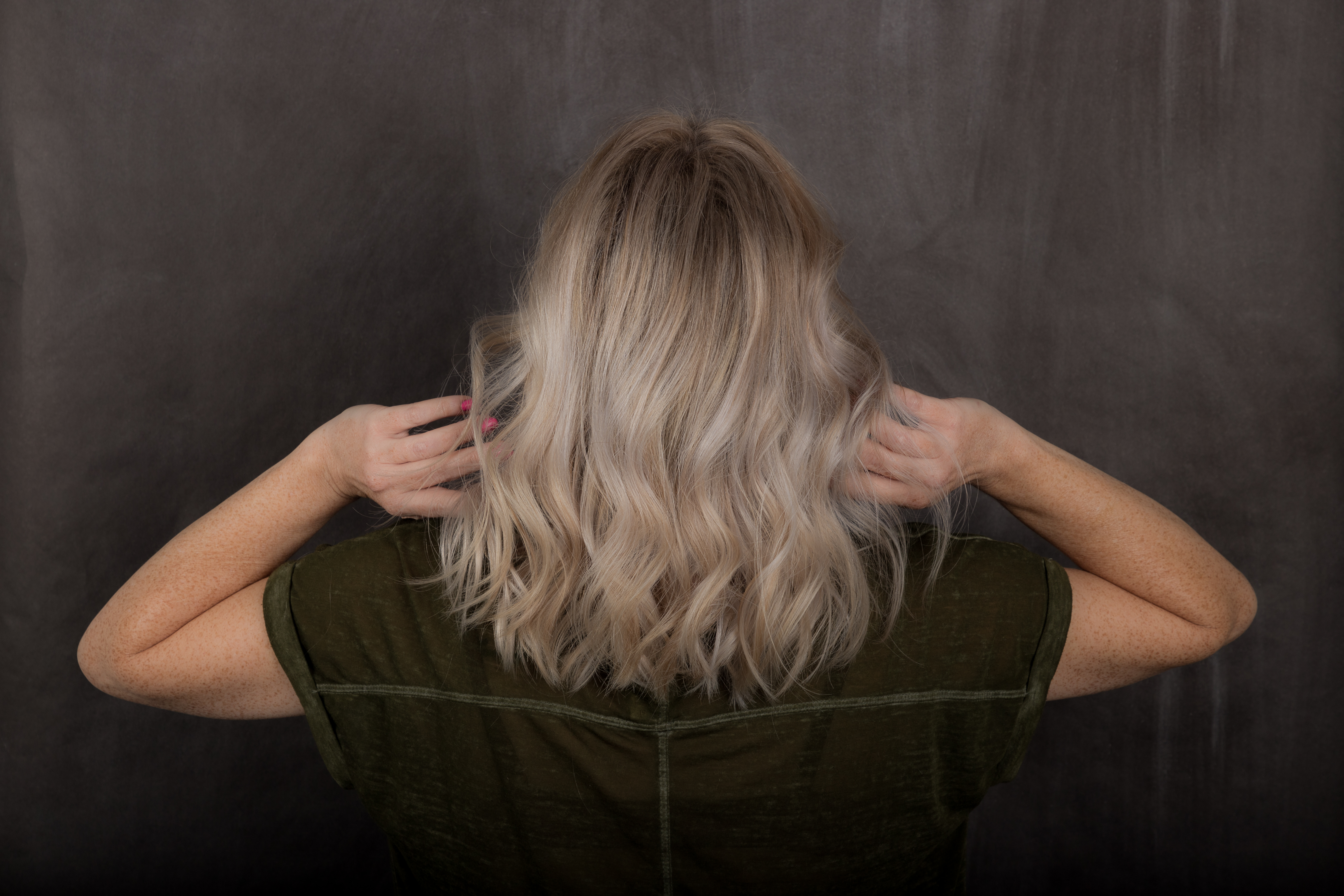 Woman With Medium Shadow Root Blonde Hairstyle