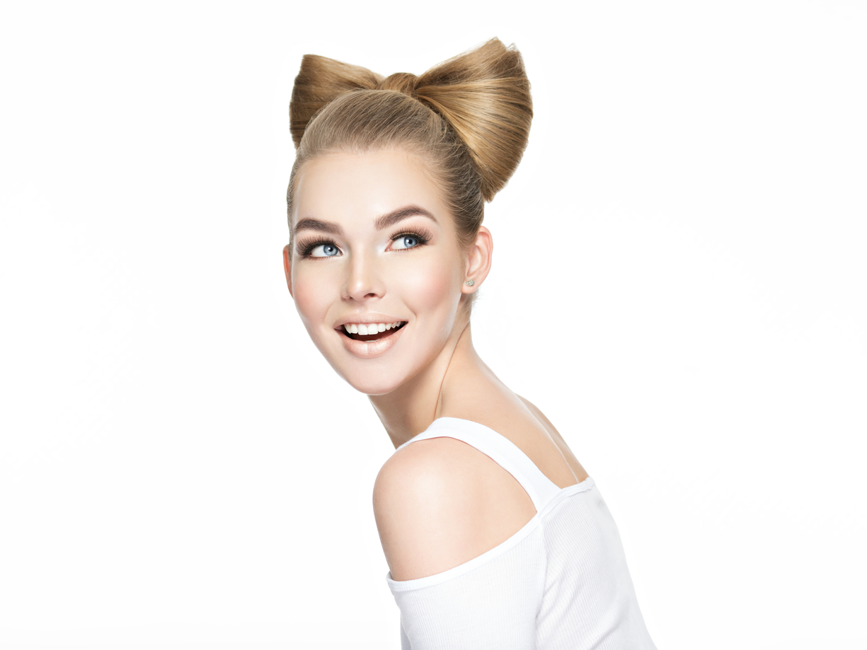 blonde woman with a bun shaped like a bow.jpg