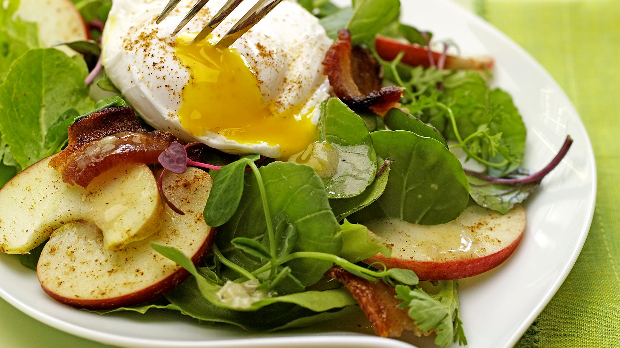 mixed-greens-with-five-spiced-bacon-and-poached-egg.jpg