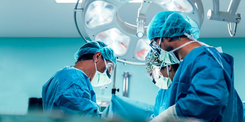 Team of Surgeons Operating.