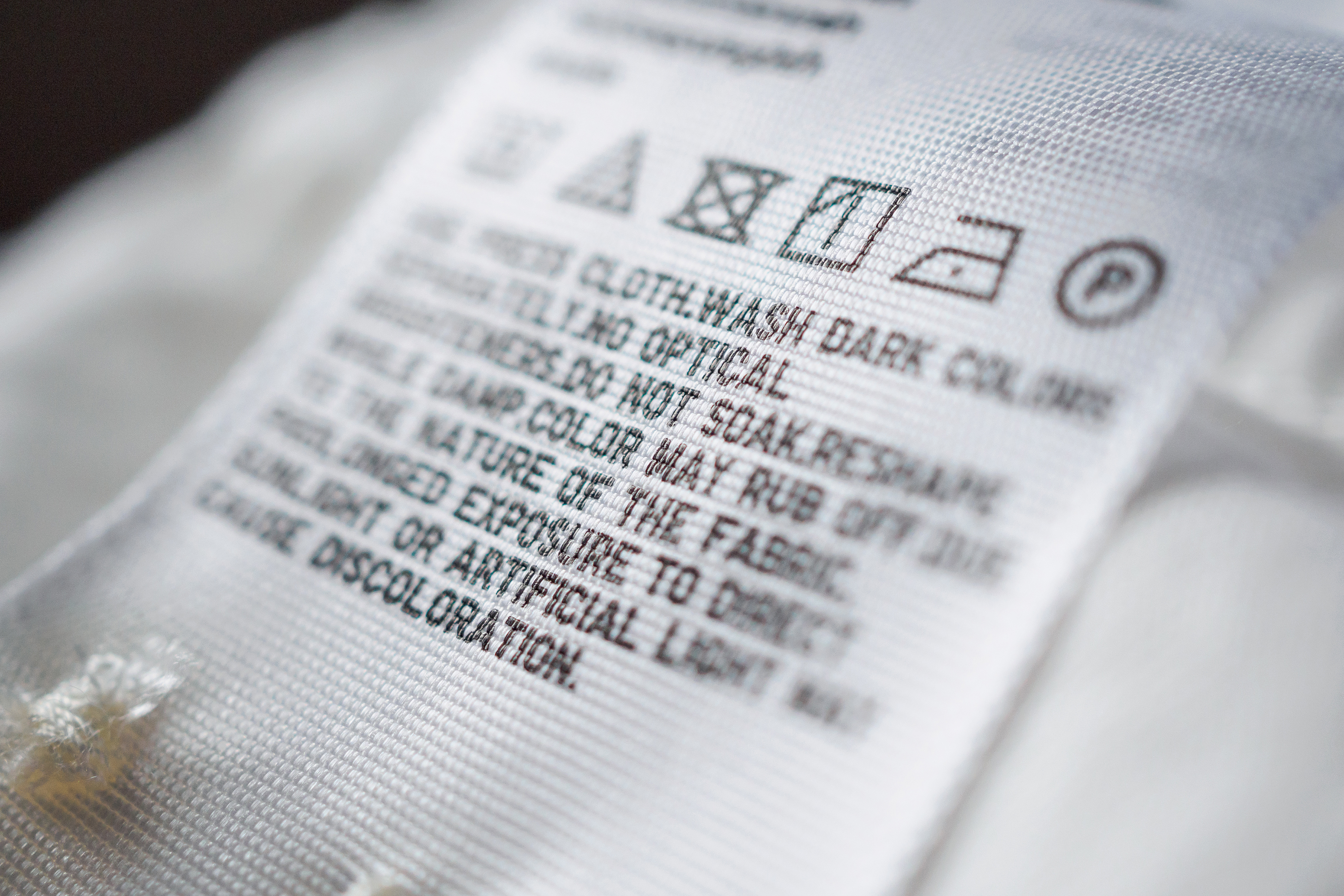 Cloth label tag with laundry care instructions.jpeg