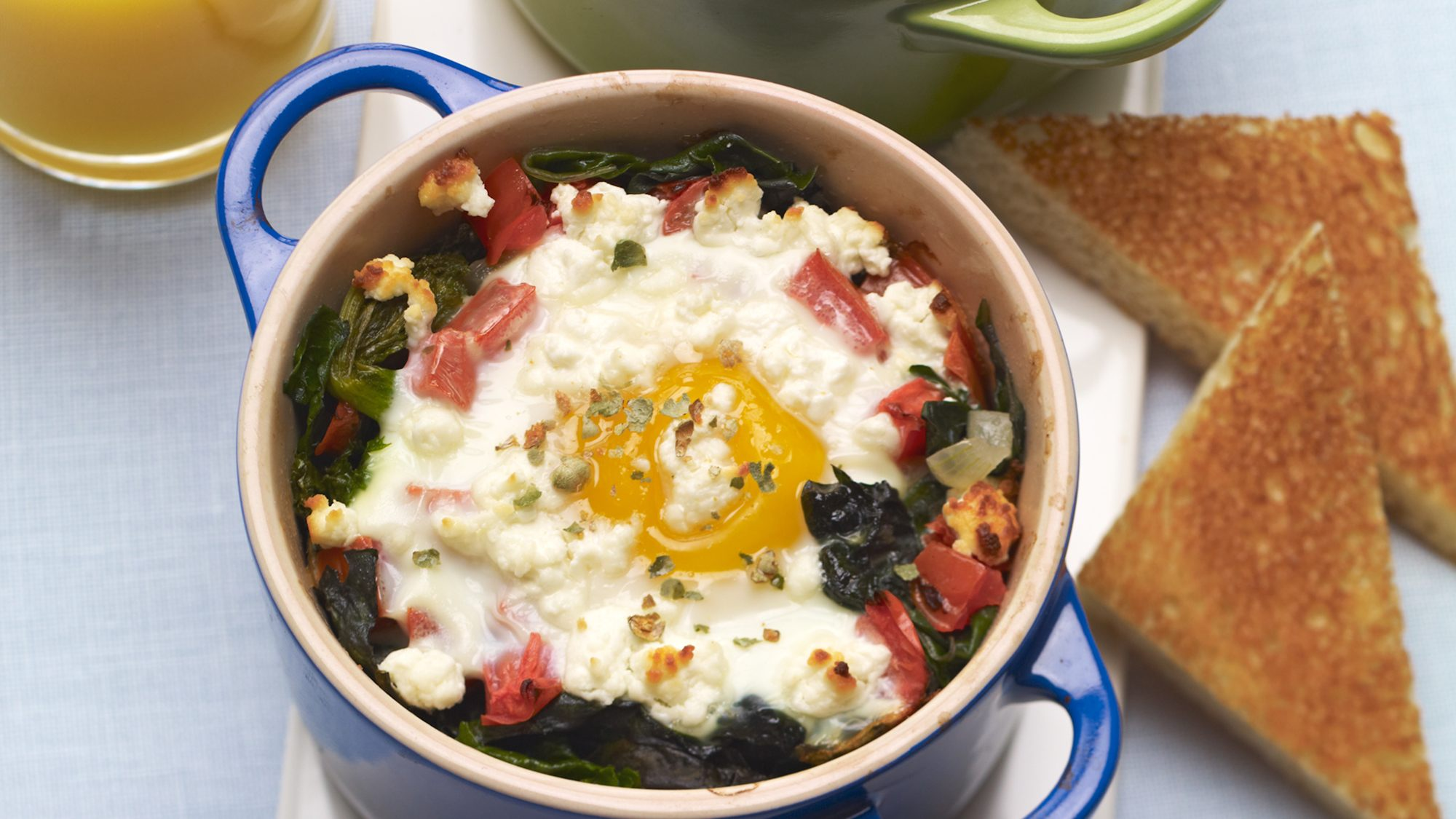 baked-eggs-with-goat-cheese-and-peppercorns.jpg