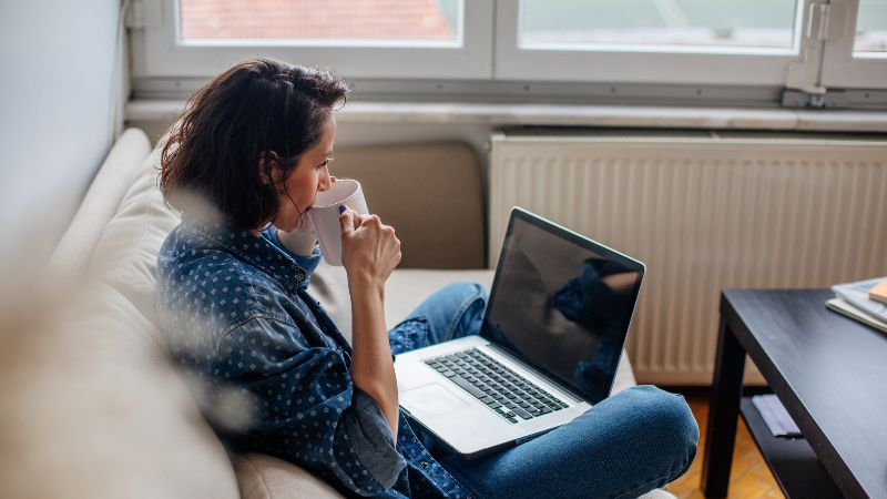 lady on sofa with laptop.jpg
