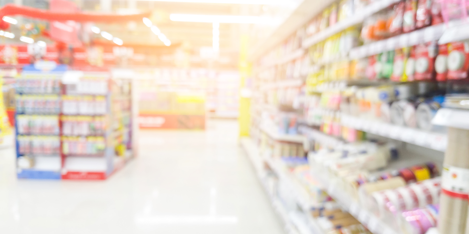 Abstract blurred image of supermarket for background.