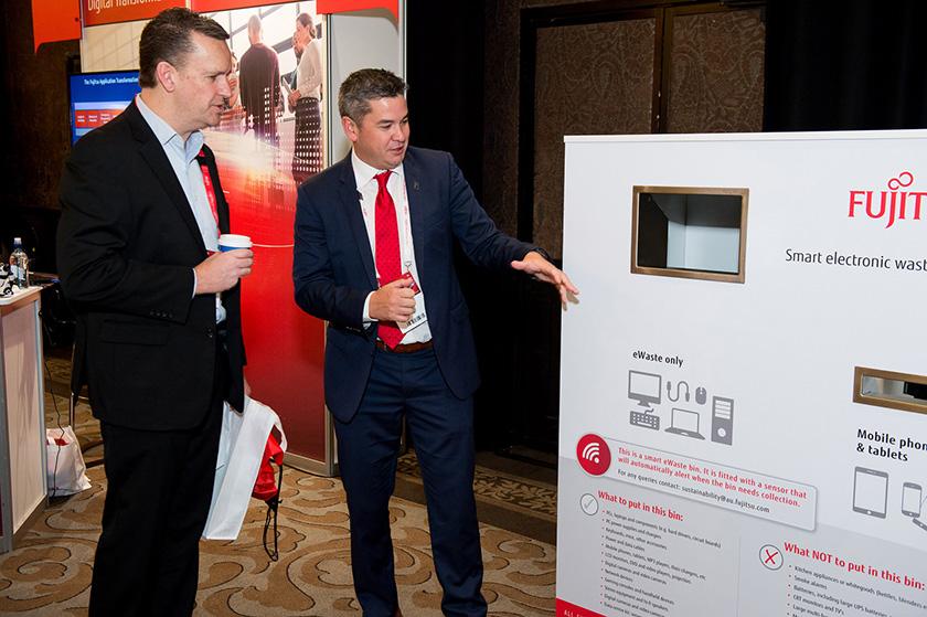 Photo : Pictured above: Lee Stewart, Head of Sustainability for Fujitsu Australia and New Zealand explaining the benefits of the Smart eWaste bin at Fujitsu World Tour 2017.
