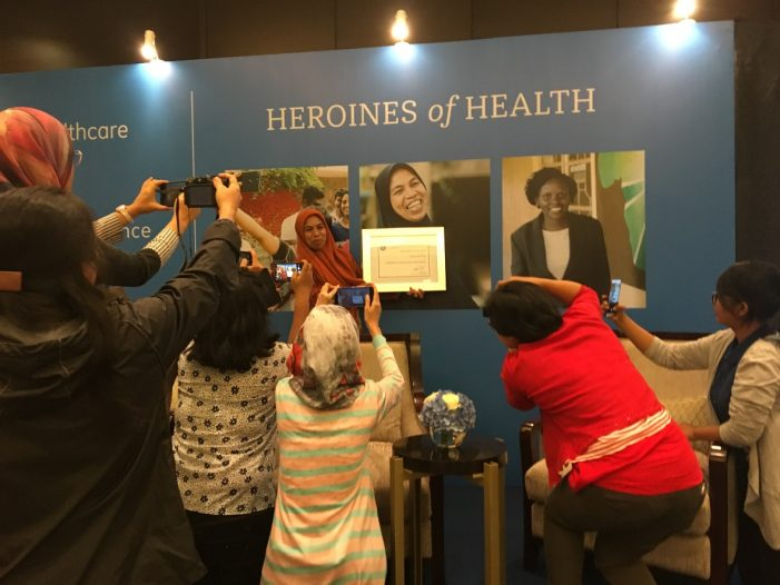 Mrs Rohani, smiling as she poses with her Heroines of Health award during the presentation in Jakarta in July 17.