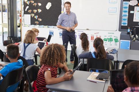 Teacher standing in front of elementary school class