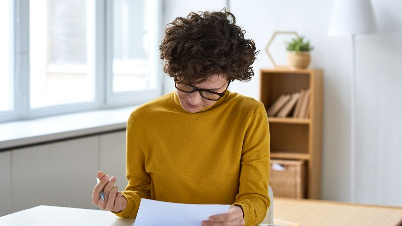iStock-1131868327 - woman doing finances.jpg