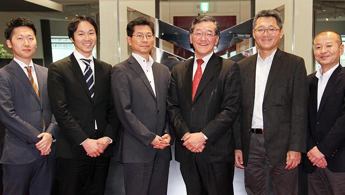 Photo : [Photo: left and next] Taku Kuramoto and Kiyoaki Daidou, Fujitsu Limited