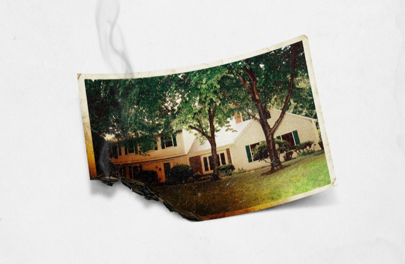 a burnt photograph sits on a white background. The photo shows a suburban home and the site of the Cheshire Murders