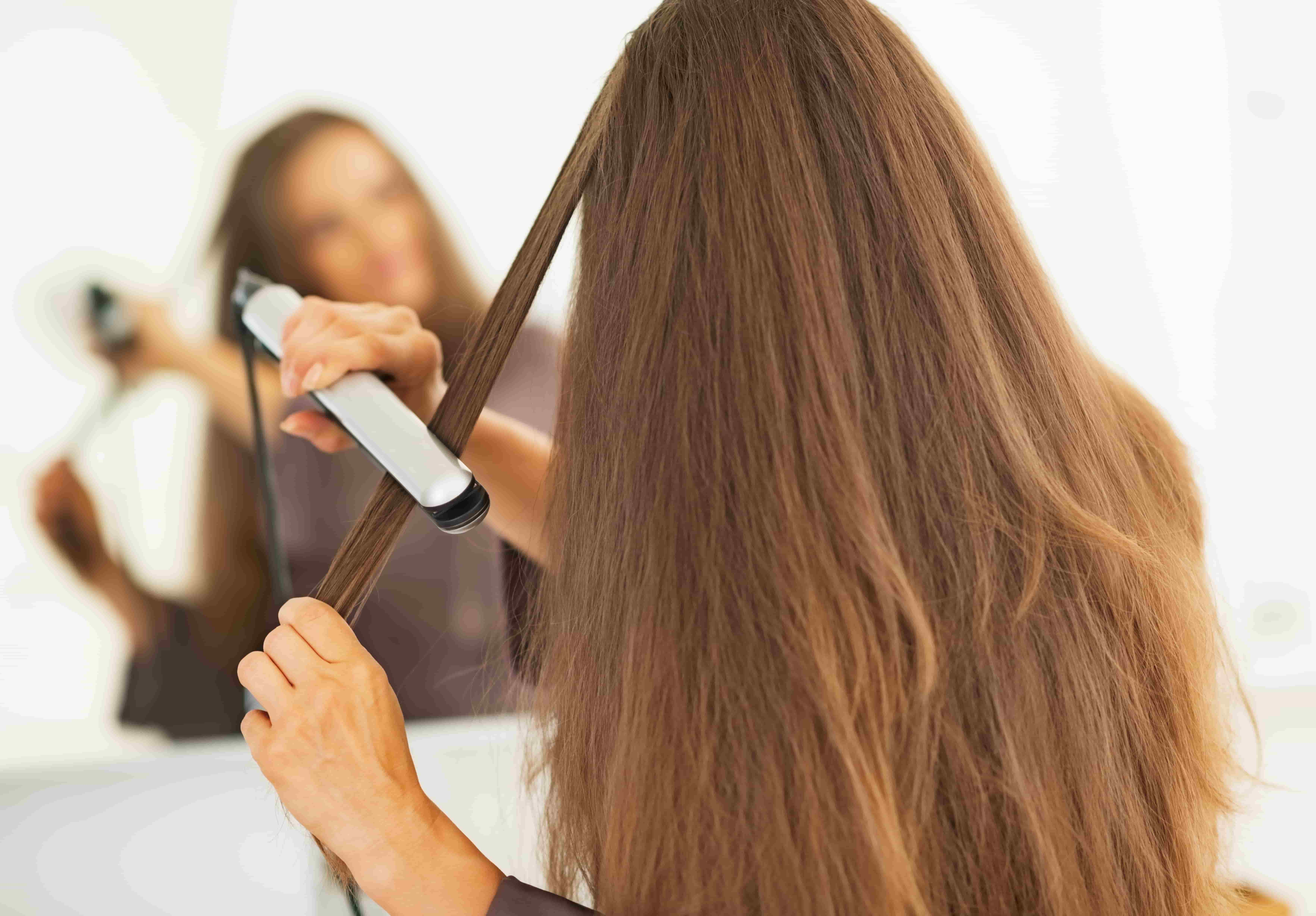 Woman with straighteners