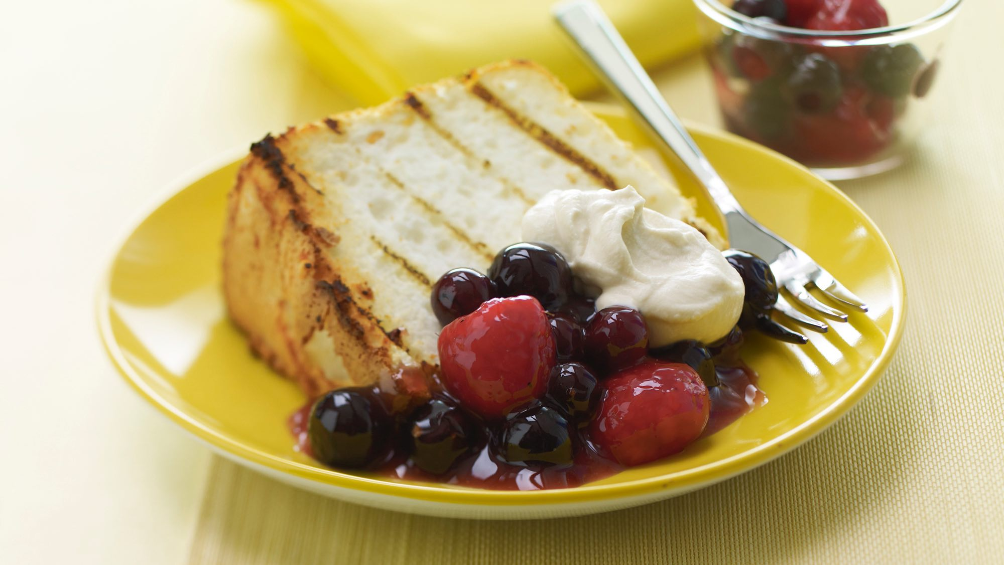 McCormick Grilled Angel Food Cake with Peppered Berries and Vanilla Cream