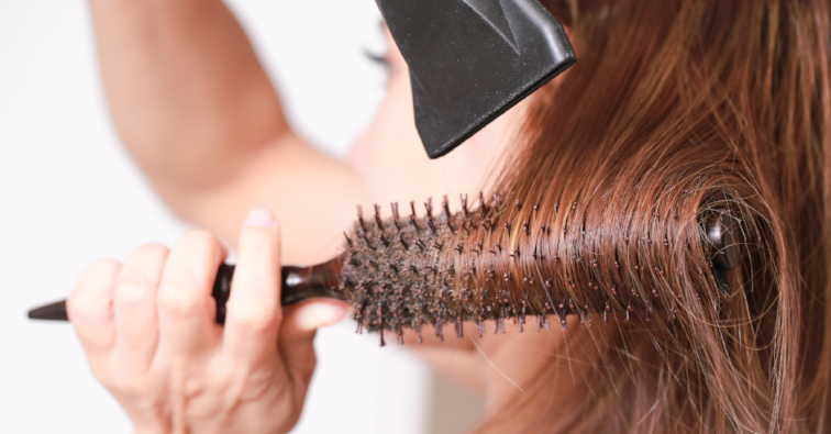 Making hairstyle using hair dryer yourself.