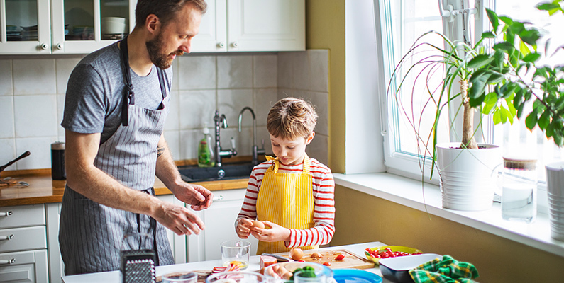 Kids cooking at home during quarantine stock photo