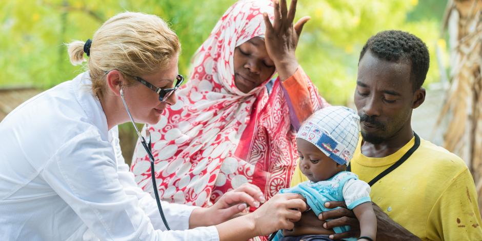 Stethoscope exam of African baby