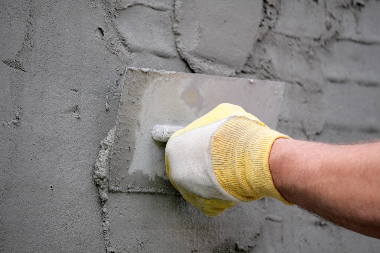 Hand holding plastering tool