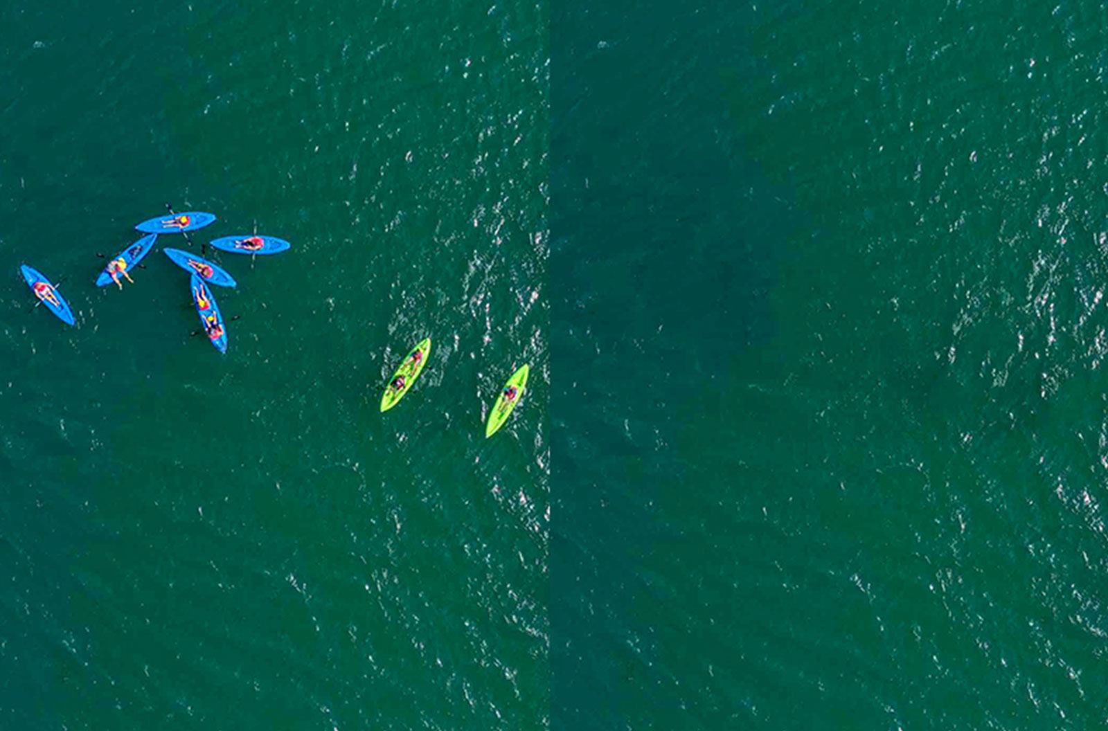 Example of a photo where spot cleaning is necessary to remove people on kayaks from the image