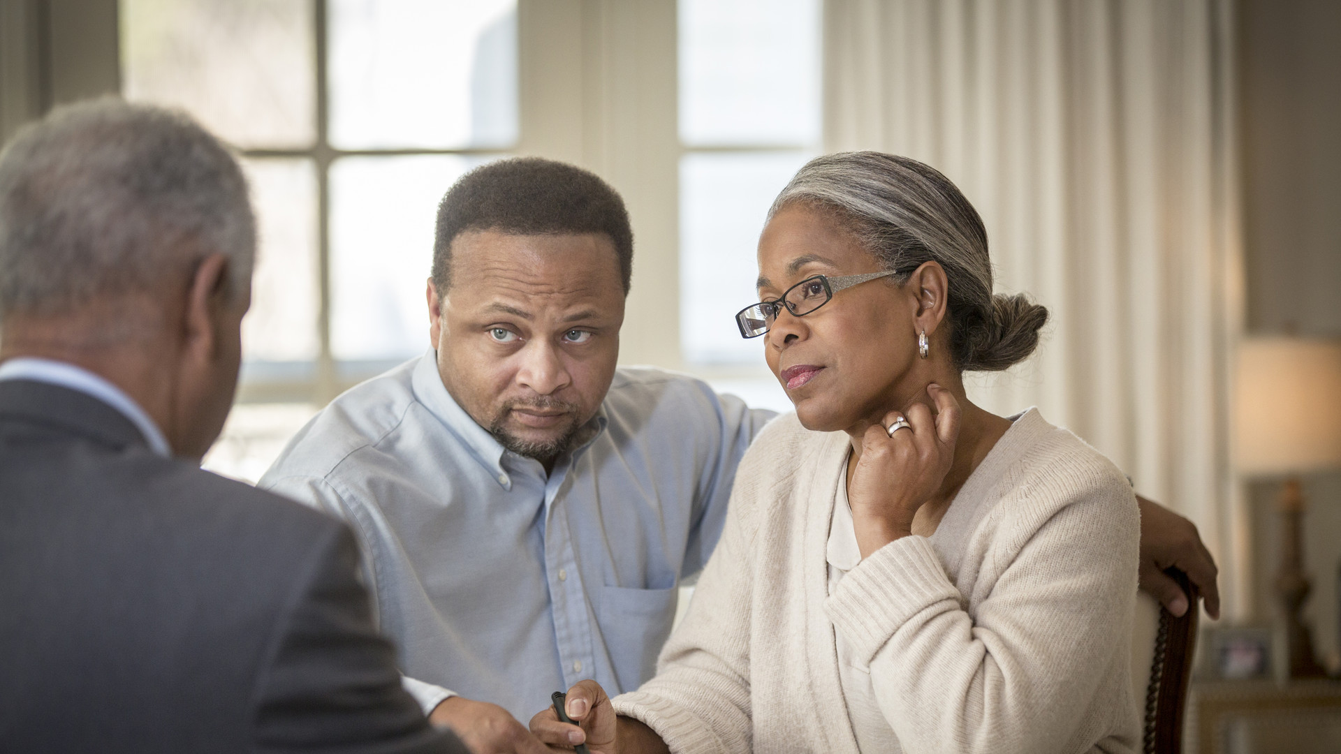 African American couple talking to businessman