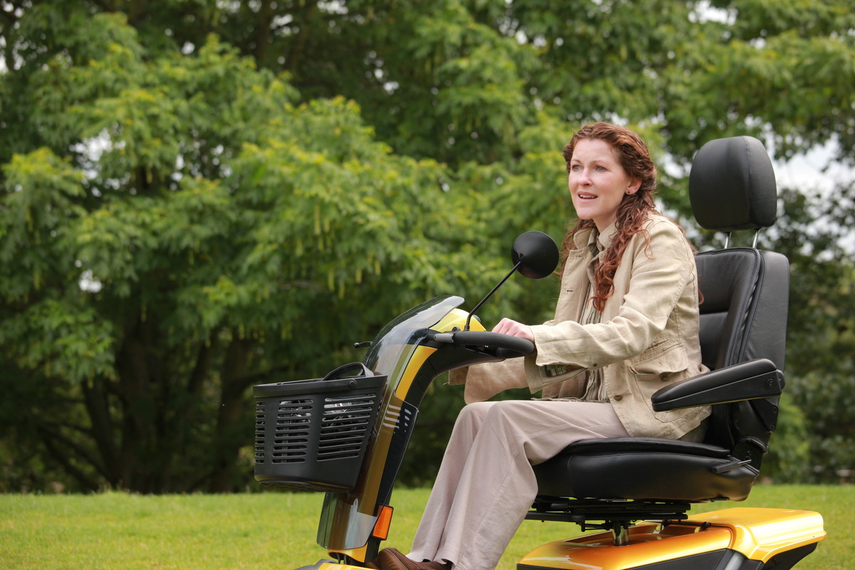 Lady driving mobility scooter.jpg