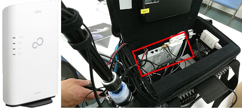 図 : (左)ヘリコプターに搭載する小型携帯電話基地局 (右)カバンの内面に装着した状態の基地局(かばん内側の赤枠の白い機器)。サイズは145(W)x 220(H)x 32(D)mm、重量わずか約600g。移動管理機能やロケーションサーバ等のモバイルコア設備を合わせても7kg以下。