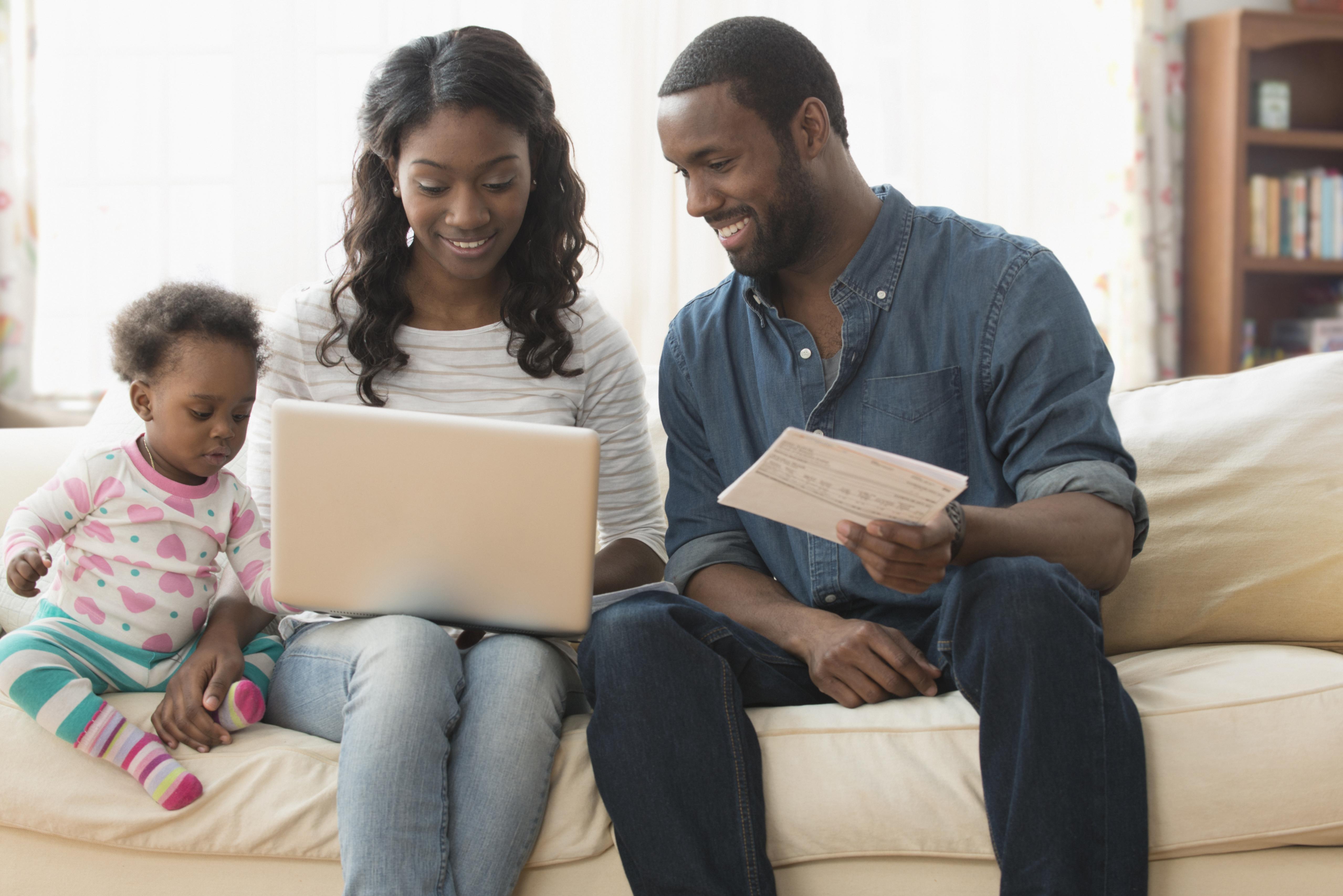 Parents paying bills on laptop