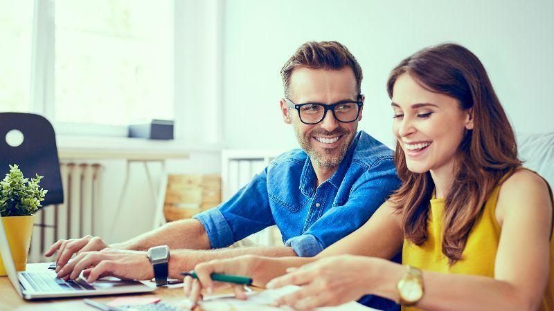 Happy couple saving for retirement