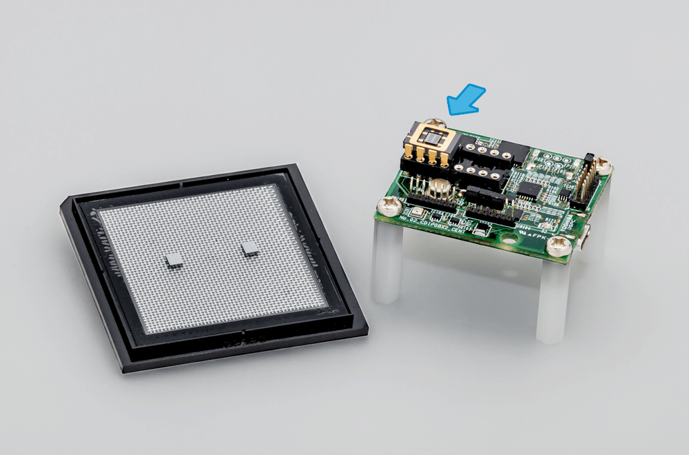 The newly developed chip, alone (left) and installed on a hydrogen sensor (right; location of chip indicated with arrow)