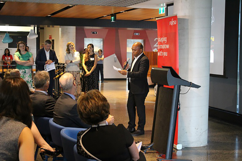 Photo : Pictured above: (Top) Minister for Bennelong, John Alexander OAM and (bottom) Jason Timor, Deputy CEO Supply Nation addressing the audience at the Fujitsu Head Office in Macquarie Park, Sydney.