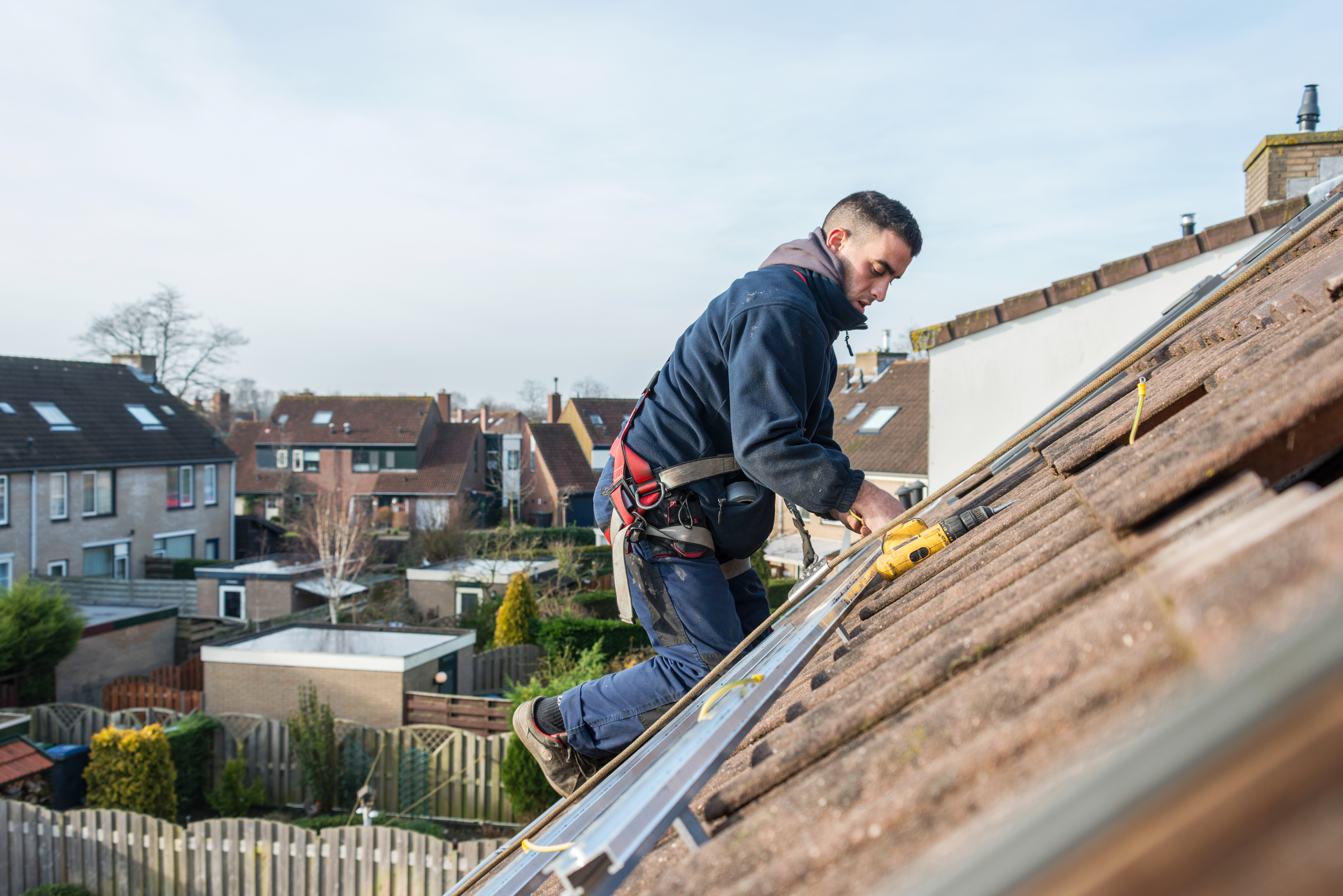 man making the construction for solar panels