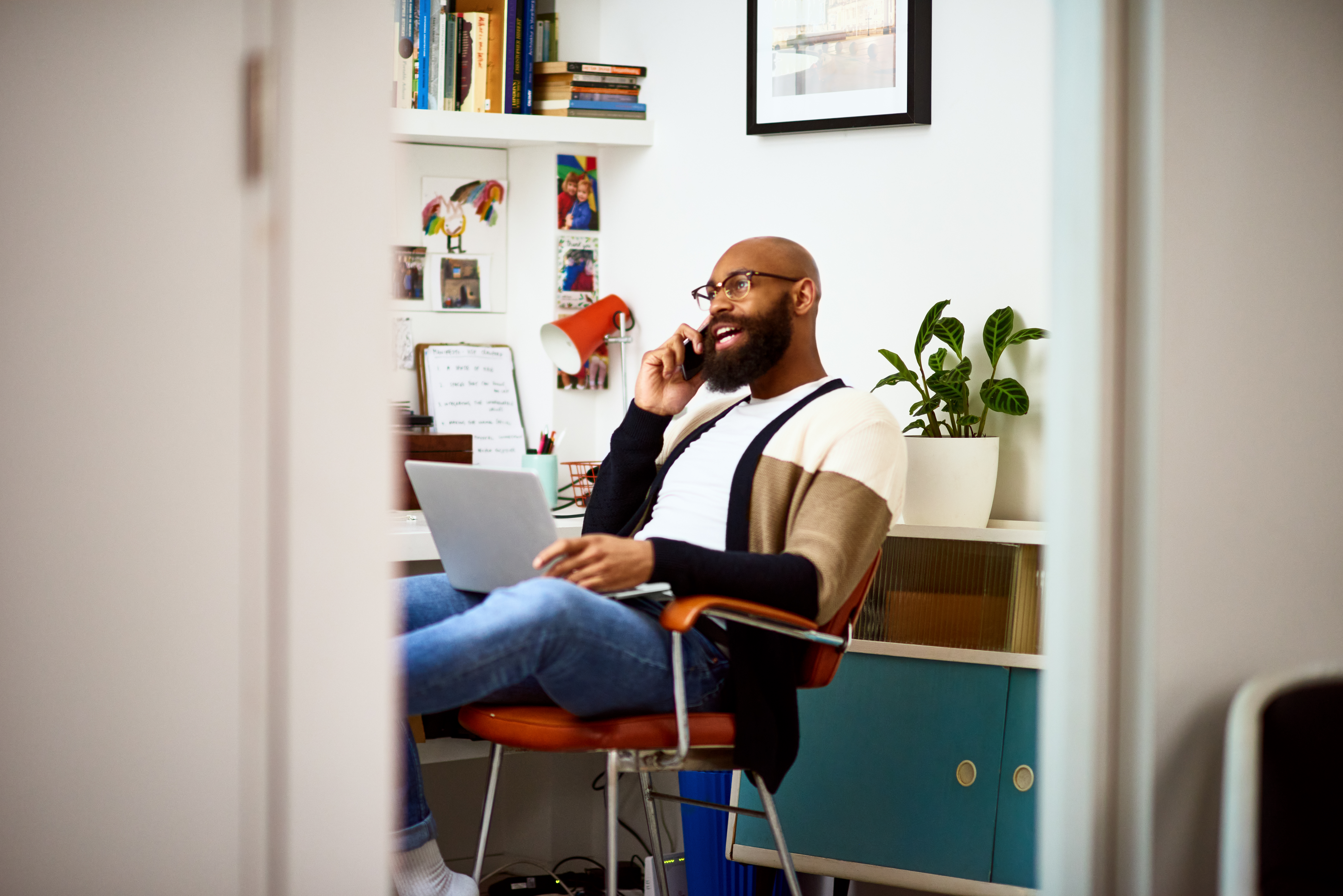 Small business owner on phone at home